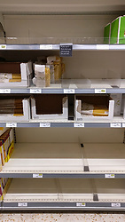 © Licensed to London News Pictures. 05/03/2020. WATFORD, UK.  Stocks of dry pasta on the shelves of a Waitrose supermarket near Watford run low as the public reacts to the threat of the coronavirus (COVID-19) in the UK.  The number of people diagnosed positive has reached 115 and the first UK death related to coronavirus has just been reported.  Photo credit: Stephen Chung/LNP