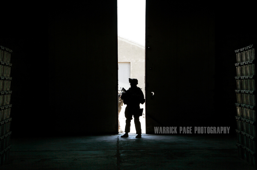 IRAQ, UNSPECIFIED - JULY: US forces inspect a warehouse containing election supplies during a patrol July, 2008, Iraq. (Photo by Warrick Page)