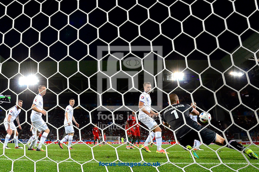 Iceland goalkeeper Hannes Halld&oacute;rsson makes a save during the UEFA Euro 2016 match at Stade Geoffroy-Guichard, Saint-&Eacute;tienne, France<br /> Picture by Kristian Kane/Focus Images Ltd 07814482222<br /> 14/06/2016
