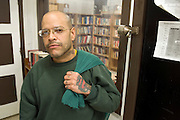 "Woodbourne Correctional Facility inmate and Bard College student Jimmy Vasquez in front of the library at Woodbourne Correctional Facility. ..Story: The Bard Prison Initiative.Former inmate Carlos Rosario, 35-year-old husband and father of four, was released from Woodbourne Correctional Facility after serving more than 12 years for armed robbery. Rosado is one of the students participating in the Bard Prison Initiative, a privately-funded program that offers inmates at five New York State prisons the opportunity to work toward a college degree from Bard College. The program, which is the brainchild of alumnus Max Kenner, is competitive, accepting only 15 new students at each facility every other year. .Carlos Rosario received the Bachelor of Arts degree in social studies from the prestigious College Saturday, just a few days after his release. He had been working on it for the last six years. His senior thesis was titled ""The Diet of Punishment: Prison Food and Penal Practice in the Post-Rehabilitative Era,"".Rosado is credited with developing a garden in one of the few green spaces inside the otherwise cement-heavy prison. In the two years since the garden's foundation, it has provided some of the only access the prison's 800 inmates have to fresh vegetables and fruit...Rosario now works for a recycling company in Poughkeepsie, N.Y...Photo © Stefan Falke"