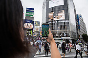 A player is catching a pokemon at the shibuya crossing, the famous intersection outside Shibuya Station. The Japanese version of the game app Pokemon Go was released on July 22, 2016. Japan McDonalds' 3,000 restaurants in Japan will be turned into Pokemon gyms in collaboration with the fast-food chain. 22/07/2016-Tokyo, JAPAN