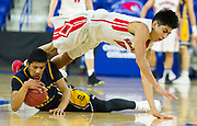 Watertown High School senior Wenston Rodriguez dives over top of Saint Mary's senior Onias Mirbel during the MIAA Division 3 North sectional final at the Tsongas Center in Lowell, March 10, 2018. Watertown won the game, 44-36.   [Wicked Local Photo/James Jesson]