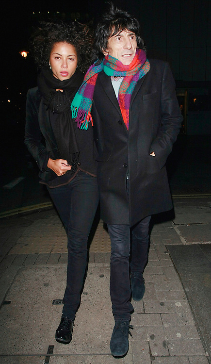 01.FEBUARY.2010.LONDON<br /> <br /> RONNIE WOOD AND HIS NEW 30-YEAR-OLD GIRLFRIEND ANA ARAUJO LEAVING NOBU RESTAURANT, PARK LANE.<br /> <br /> *THIS IMAGE IS STRICTLY FOR UK NEWSPAPERS &amp; MAGAZINES ONLY*<br /> *FOR WORLDWIDE SALES &amp; WEB USE OR MORE INFO PLEASE CONTACT EDBIMAGEARCHIVE - 0208 954 5968*
