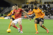 Wolverhampton Wanderers defender Ethan Ebanks-Landell holds up Nottingham Forest striker Nelson Oliveira during the Sky Bet Championship match between Wolverhampton Wanderers and Nottingham Forest at Molineux, Wolverhampton, England on 11 December 2015. Photo by Alan Franklin.