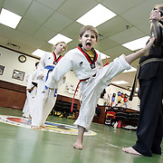 New City, NY / 2009 - Ariel Ashirov, 6, left, trains with instructor Steven Leopold, right, at Master Jung and Master Yu Traditional Tae Kwon Do Academy in New City Jan. 19.  ( Mike Roy / The Journal News )