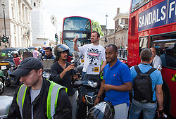 Image ©Licensed to i-Images Picture Agency. 11/06/2014. London, United Kingdom. Drivers of London black cabs \'gridlock\' the area around Whitehall. Drivers of black cabs and The Knowledge Taxi motorcycles \'gridlock\' the area around Trafalgar Square and government buildings on Whitehall in a protest against the Uber app-based service. Whitehall, London. Picture by Daniel Leal-Olivas / i-Images