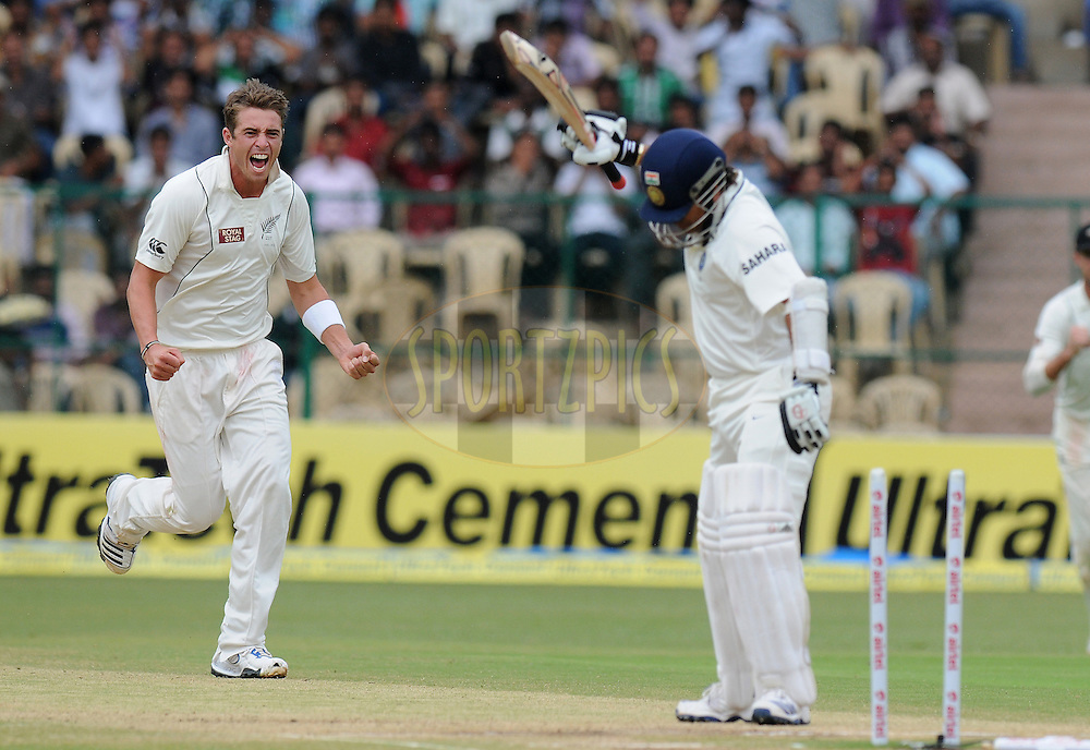 Tim Southee of New Zealand celebrates as Sachin Tendulkar of India stands dejected after getting bowled out during day four of the second test match between India and New Zealand held at the M. Chinnaswamy Stadium, Bengaluru on the 3rd September 2012..Photo by Pal Pillai/BCCI/SPORTZPICS