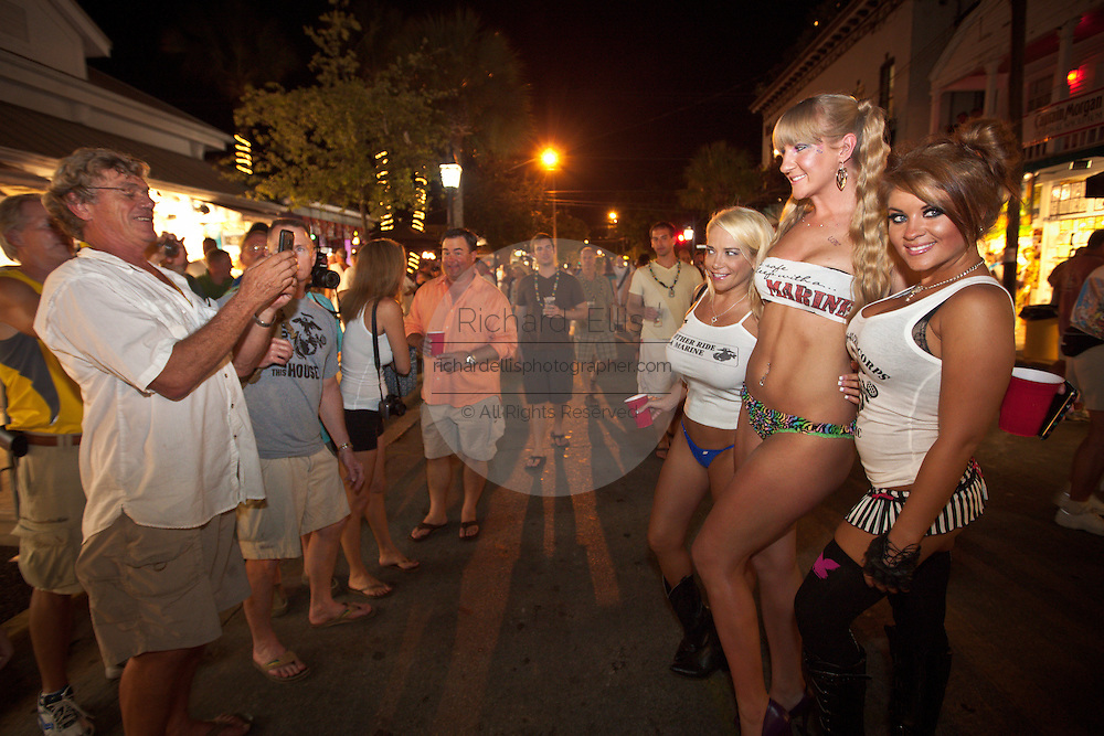 Revelers pose for pictures during Fantasy Fest halloween parade in Key West, Florida.