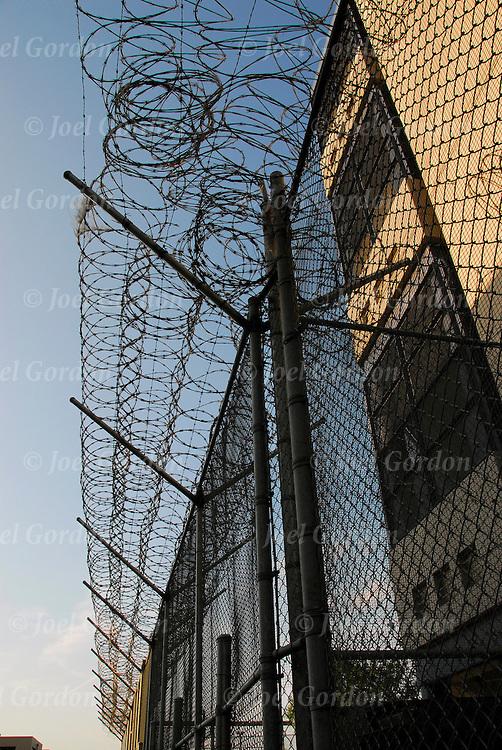 Orange County Jail, exterior perimeter razor wire fence around jail facilities.