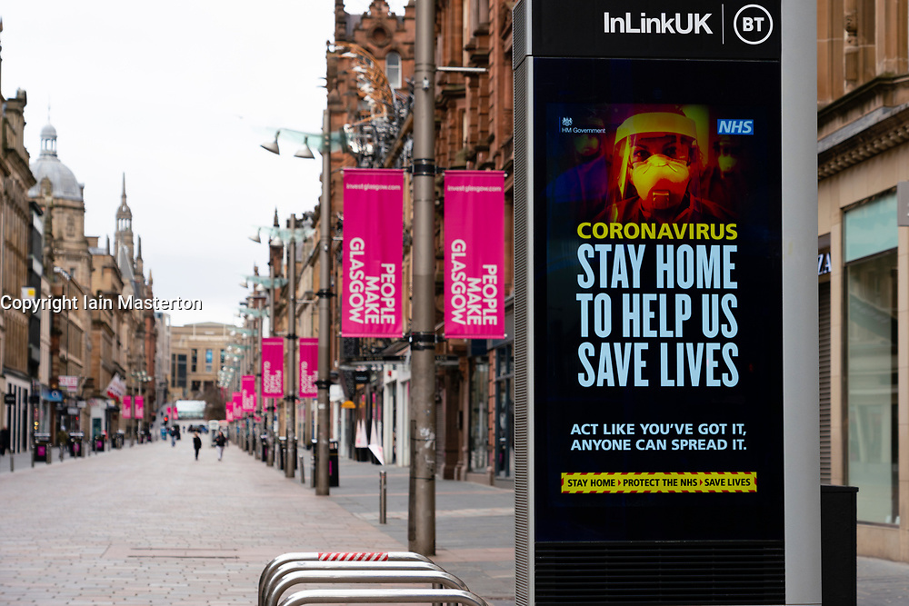 Glasgow, Scotland, UK. 1 April, 2020. Effects of Coronavirus lockdown on Glasgow life, Scotland. Video screen showing coronavirus warning message on Buchanan Street.