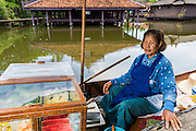 16 JULY 2014 - SAMUT PRAKAN, SAMUT PRAKAN, THAILAND: A fruit vendor in the floating market in Ancient Siam. Ancient Siam is a historic park about 200 acres (81 hectares) in size in the city of Samut Prakan, province of Samut Prakan, about 90 minutes from Bangkok. It features historic recreations of important Thai landmarks and is shaped roughly like the country of Thailand.      PHOTO BY JACK KURTZ
