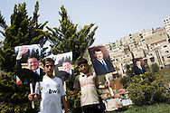 JORDAN, Amman : Jordanian protesters gather around portraits of the King Abdullah II during a pro government demonstration in Amman on April 1, 2011, as they called for reforms, a week after clashes between them and government supporters killed a man and injured 160. ALESSIO ROMENZI