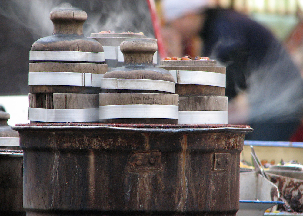 Wooden pots, set atop a steamer, keep food warm and tasty for the evening dinner crowd in the city of Xi'an, Shaanxi province.