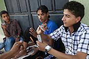 Boys play cards in Zintan.