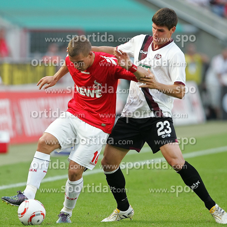 21.08.2010,  Rhein Energie Stadion, Koeln, GER, 1.FBL, FC Koeln vs 1. FC Kaiserslautern, 1. Spieltag, im Bild: Lukas Podolski (Koeln #10) / Florian DICK (Kaiserslauern #23 GER)  EXPA Pictures © 2010, PhotoCredit: EXPA/ nph/  Mueller+++++ ATTENTION - OUT OF GER +++++ / SPORTIDA PHOTO AGENCY