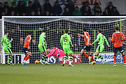 Luton's Danny Hylton shoots at goal, saved by Forest Green Rovers goalkeeper Bradley Collins(1) during the EFL Sky Bet League 2 match between Forest Green Rovers and Luton Town at the New Lawn, Forest Green, United Kingdom on 16 December 2017. Photo by Shane Healey.