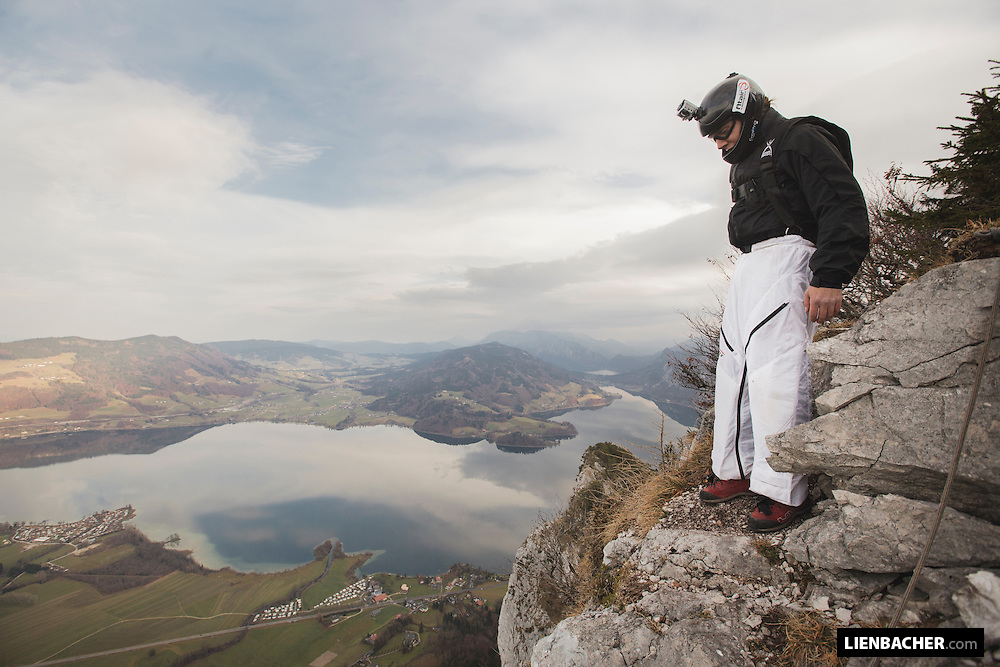 BASE jumper Wolfgang Rainer is standing at the exit of the Drachenwand (dragon wall) in Mondsee, ready to jump