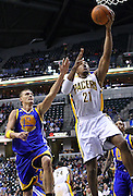 Feb. 28, 2012; Indianapolis, IN, USA; Indiana Pacers power forward David West (21) shoots the ball as Golden State Warriors center Andris Biedrins (15) defends from behind at Bankers Life Fieldhouse. Mandatory credit: Michael Hickey-US PRESSWIRE