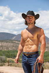 sexy shirtless muscular cowboy on a ranch