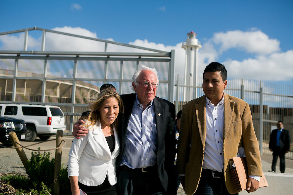 SAN DIEGO, CA - MAY 21, 2016: Democratic presidential candidate Bernie Sanders visits the U.S.-Mexico border at International Friendship Park alongside Maria Puga, whose husband Anastacio Hernandez Rojas died after an incident with Border Patrol agents and Christian Ramirez, director of Southern Border Communities Coalition in San Diego, California. CREDIT: Sam Hodgson for The New York Times.