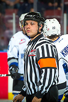 KELOWNA, CANADA - OCTOBER 4:  Referee Nick Panter stands on the ice at the Kelowna Rockets against the Victoria Royals on October 4, 2017 at Prospera Place in Kelowna, British Columbia, Canada.  (Photo by Marissa Baecker/Shoot the Breeze)  *** Local Caption ***