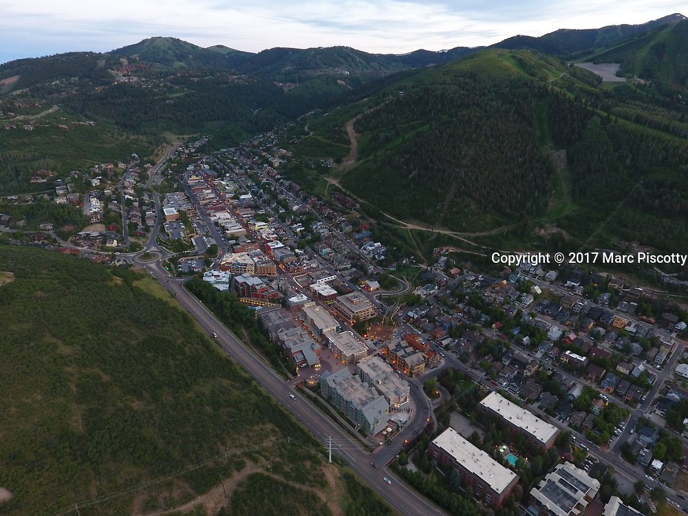 SHOT 7/1/17 9:08:02 PM - Drone photos of Park City, Utah. Park City lies east of Salt Lake City in the western state of Utah. Framed by the craggy Wasatch Range, it's bordered by the Deer Valley Resort and the huge Park City Mountain Resort, both known for their ski slopes. Utah Olympic Park, to the north, hosted the 2002 Winter Olympics and is now predominantly a training facility. In town, Main Street is lined with buildings built during a 19th-century silver mining boom. (Photo by Marc Piscotty / © 2017)