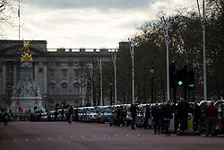 © Licensed to London News Pictures. 10/02/2016. London, UK. Black cabs line The Mall leading to Buckingham Palace as Thousands of London black cab drivers stage a protest in Westminster, London against Government interference in the taxi industry and 'active support' for Uber, which they allege is a 'tax avoiding global corporation' Photo credit: Ben Cawthra/LNP