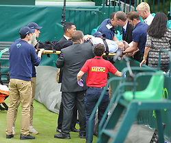 GREAT BRITAINS JAMES WARD  GAME IS STOPPED AFTER A SPECTATER IS TAKEN ILL AND HAS TO BE STRETCHED OF THE COURT, The Boddles Tennis Tournament,  Stoke Park Bucks, 29th June 2017<br /> Photo:Mike Capps