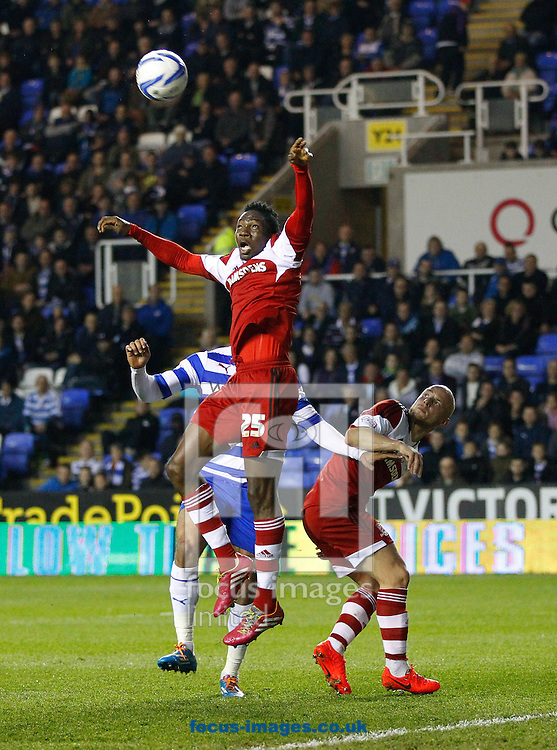 Kenneth Omeruo of Middlesborough (25) leaps for a high ball against Hal Robson-Kanu of Reading (obscured) during the Sky Bet Championship match at the Madejski Stadium, Reading<br /> Picture by Andrew Tobin/Focus Images Ltd +44 7710 761829<br /> 22/04/2014