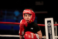Boxing: US Olympic Trials: Isabel Hernandez (black) during exhibition fight vs Maria Moore (red) at Northern Quest Resort..Spokane, WA 2/17/2012.CREDIT: Jed Jacobsohn (Photo by Jed Jacobsohn /Sports Illustrated/Getty Images).(Set Number: X86862 TK2 R1 F193 )