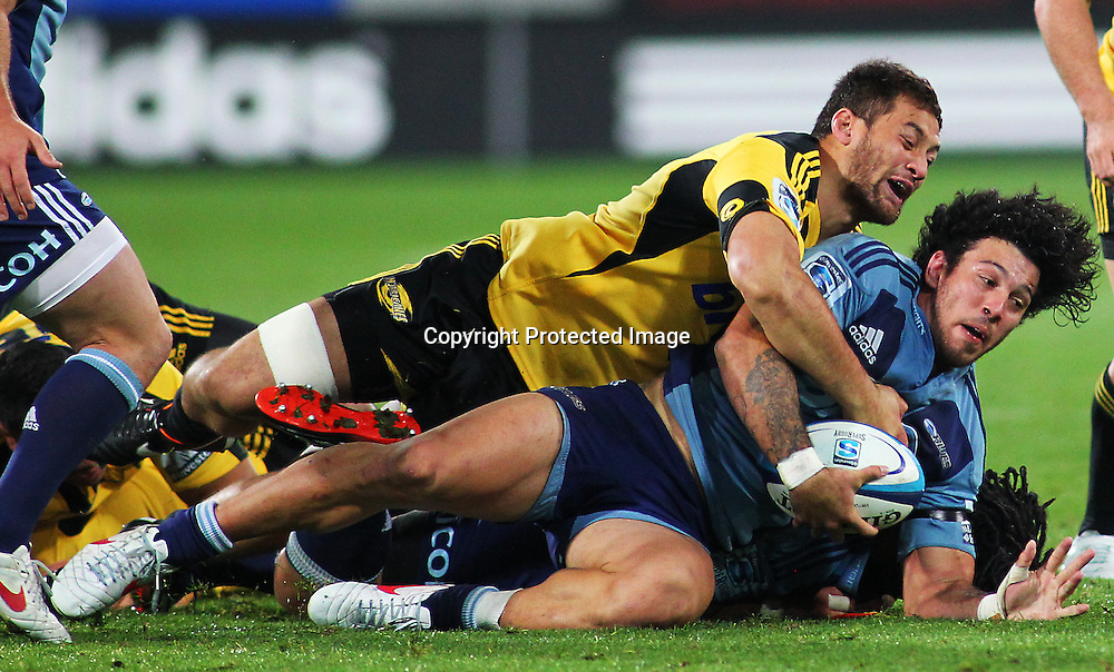 Rene Ranger is tackled during their Super Rugby match, Hurricanes v Blues, Westpac stadium, Wellington, New Zealand. Friday 4 May 2012.  PHOTO: Grant Down / photosport.co.nz