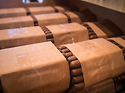 30 APRIL 2015 - TAMPA, FLORIDA, USA: Hand rolled cigars in Tabanero Cigars, a cigar factory and coffee house in the Ybor City section of Tampa, FL. Tabanero Cigars handrolls cigars in the traditional Cuban style. Most of the rollers at Tabanero have immigrated to the US from Cuba. Ybor is a historically Cuban immigrant community that has been redeveloped and gentrified into a popular tourist destination lined with cigar factories, boutiques and cafes.     PHOTO BY JACK KURTZ