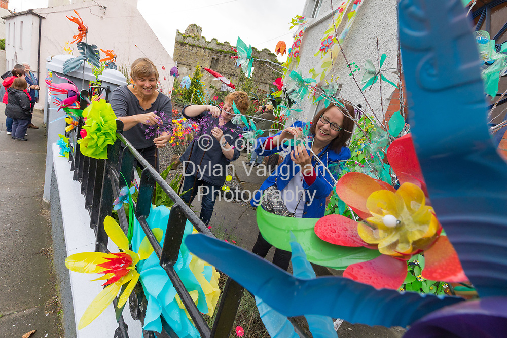 11-8-17<br /> The Art of Recycling<br /> Installation Flora is a community based art project in Thomastown, Co. Kilkenny as part of the AKA (Alternative Kilkenny Arts) Fringe Festival 2017. <br /> <br /> A front garden on Ladywell Street has been transformed into a veritable paradise of flowers, leaves and garden insects.  It is a world of artful ideas of upcycling and recycling material.  You will see a wealth of recyclables such as bags, tins, clothes hangers, fabric and plastic bottles upcycled into flowers, leaves and other garden sights.  A transformation of rubbish/recycle into the beautiful. <br /> <br /> Pictured in the garden are from left three members of the group that put the garden together, Nancy Paton, Polly Donnellan and Catherine Green.<br /> <br /> It began with the idea of decorating the railings of a house for the AKA (Alternative Kilkenny Arts) Fringe Festival 2017, and grew to encompass the entire front garden. It is the collaboration of several local women and the result of a year of making these creations.<br /> We are pleased with the results of our efforts and look forward to sharing them with the public during the AKA (Alternative Kilkenny Arts) Fringe Festival 2017. The garden is located on Ladywell and can be seen from the street. It will be open from 12-4 most days of the Festival. <br /> <br /> Picture Dylan Vaughan.<br /> <br /> Location: San Antonio, Ladywell, Thomastown