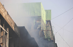 Smoke rises from burning market in Kabul, Afghanistan , December 23, 2012. Photo by Imago / i-Images...UK ONLY