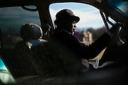 "MONTGOMERY, AL – JANUARY 25, 2016: Michael Harris, 52, waits for a client outside the new Greyhound station. In 2011, the downtown Montgomery Greyhound bus station was converted into a museum to honor the freedom riders, who endured a violent attack there in 1961. The replacement bus station, located four miles from downtown, is a prime business opportunity for independent cabbies like Michael Harris, who make a living serving passengers unwilling to rely on city buses. Many characterize the public bus system in Montgomery as unsafe and unreliable, so wary passengers cough up $2 per mile for trips in Mr. Harris' 2005 Lincoln Navigator, traveling across town for fast food, or sometimes as far as New York City. ""This is my life,"" Harris said. ""I love driving, and I help people out. It's just in my heart."""