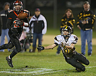 Springville's Kolton Markley (21) breaks up a pass intended for Midland's Seth Groth (85) during their game at Allison Field in Springville on Friday October 19, 2012. Midland defeated Springville 30-29.