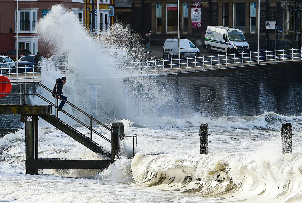 © London News Pictures. 02/02/2017. Aberystwyth, UK.<br /> Strong winds and high tides this morning bring huge waves crashing into the promenade and sea defences in Aberystwyth on the west  wales coast. More strong and potentially damaging gales , with gusts in excess of 60mph are forecast to strike parts of southern UK tomorrow. Photo credit: Keith Morris/LNP