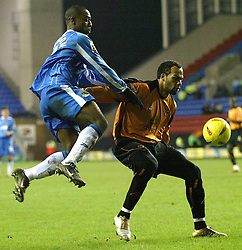 WIGAN, ENGLAND - Tuesday, January 4, 2005: Wolverhampton Wanderers' Joleon Lescott and Wigan's Nathan Ellington during the League Championship match at the JJB Stadium. (Pic By Dave Kendall/Propaganda)