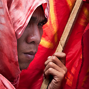 MANILA (Philippines). 2009. Left-wing protester with a red flag during a demonstration in Manila.