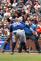 SAN FRANCISCO, CA - MAY 25: Yangervis Solarte #26 of the San Diego Padres is tagged out at home plate by Trevor Brown #14 of the San Francisco Giants in front of umpire Mike Winters #33 during the first inning at AT&T Park on May 25, 2016 in San Francisco, California.  (Photo by Jason O. Watson/Getty Images) *** Local Caption *** Yangervis Solarte; Trevor Brown; Mike Winters