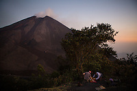 Antigua, Guatemala - March 09, 2015: Hikers enjoy a snack after a day exploring Pacaya, an active volcano that last erupted in 2010. Even though it peaks at 8,373 feet, it's a relatively easy hike and guides famously bring marshmellows to melt in the lava flow.  CREDIT: Chris Carmichael for The New York Times
