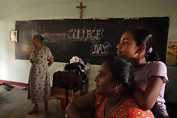 Refugees rest inside St. Cecilia's Convent classrooms, Batticaloa, Sri Lanka, Jan. 14, 2005. Residents of the small Christian village Dutch Bar spent more than six weeks in a makeshift refugee camp at the local convent recovering from the devastating tsunami that hit the eastern and southern borders of Sri Lanka. They were then moved into another temporary living camp, while awaiting the building of new homes.