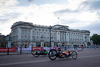 Riders cycle past Buckingham Palace in The Prudential RideLondon Handcycle Grand Prix. Saturday 28th July 2018<br /> <br /> Photo: Jed Leicester for Prudential RideLondon<br /> <br /> Prudential RideLondon is the world's greatest festival of cycling, involving 100,000+ cyclists - from Olympic champions to a free family fun ride - riding in events over closed roads in London and Surrey over the weekend of 28th and 29th July 2018<br /> <br /> See www.PrudentialRideLondon.co.uk for more.<br /> <br /> For further information: media@londonmarathonevents.co.uk