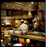 Sushi restaurant where sushi is delivered on a conveyor belt, Tokyo, Japan.