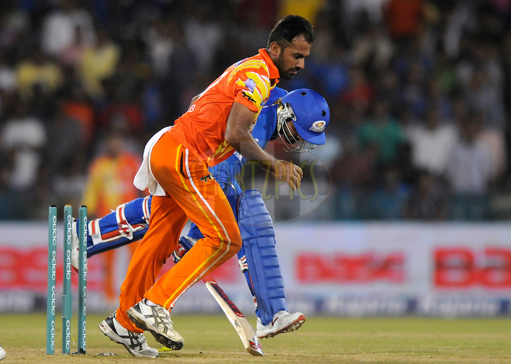 Wahab Riaz of Lahore Lions gets Harbhajan Singh of Mumbai Indians run out during the qualifier 2 match of the Oppo Champions League Twenty20 between the Mumbai Indians and the Lahore Lions held at the Chhattisgarh International Cricket Stadium, Raipur, India on the 13th September 2014<br /> <br /> Photo by:  Pal Pillai / Sportzpics/ CLT20<br /> <br /> <br /> Image use is subject to the terms and conditions as laid out by the BCCI/ CLT20.  The terms and conditions can be downloaded here:<br /> <br /> <br /> http://sportzpics.photoshelter.com/gallery/CLT20-Image-Terms-and-Conditions-2014/G0000IfNJn535VPU/C0000QhhKadWcjYs