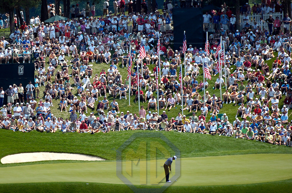07 July 2007:  Tiger Woods putts in front of a large gallery on the 10th hole in the third round of the inaugural AT&T National PGA event at Congressional Country Club in Bethesda, Md.  ****For Editorial Use Only****