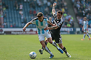 Jamie Paterson (Huddersfield Town) and Sam Saunders (Brentford) during the Sky Bet Championship match between Huddersfield Town and Brentford at the John Smiths Stadium, Huddersfield, England on 7 May 2016. Photo by Mark P Doherty.