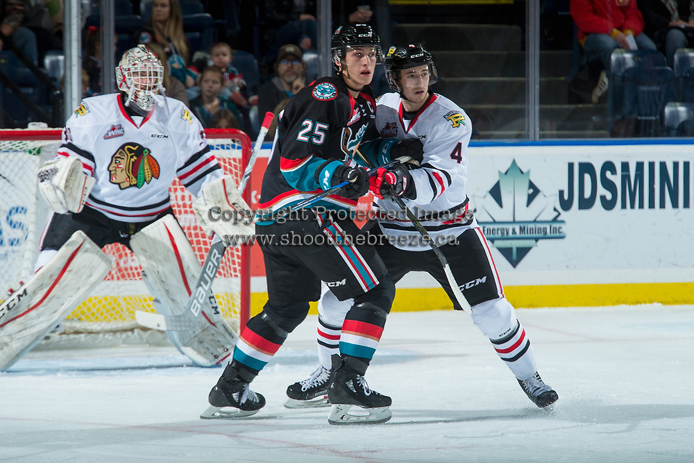 KELOWNA, CANADA - OCTOBER 20: Conor MacEachern #4 of the Portland Winterhawks checks Cal Foote #25 of the Kelowna Rockets during first period on October 20, 2017 at Prospera Place in Kelowna, British Columbia, Canada.  (Photo by Marissa Baecker/Shoot the Breeze)  *** Local Caption ***