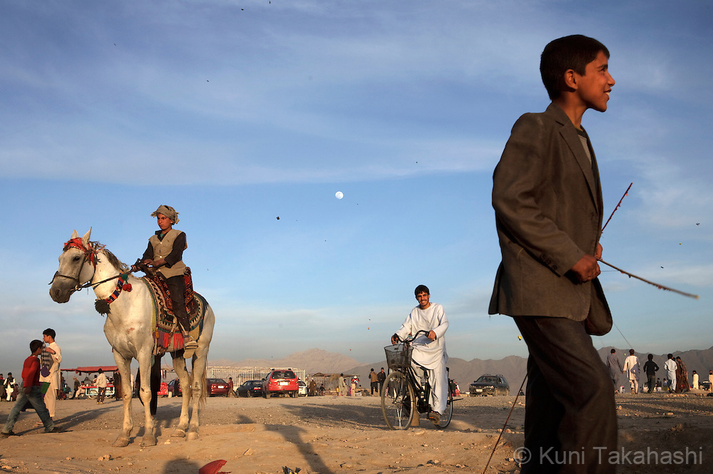 (Kabul Afghanistan - May 4, 2012).Young people play on top of the hill in Kabul, Afghanistan on May 4, 2012. With an estimated population of 30 million, the war-torn country has been struggling to rebuild while political instability continues. .(Photo by Kuni Takahashi)
