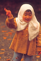 child waving Rural area, Tokyo, Japan